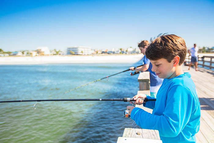 Two boys fishing at the pier in Mexico Beach Florida