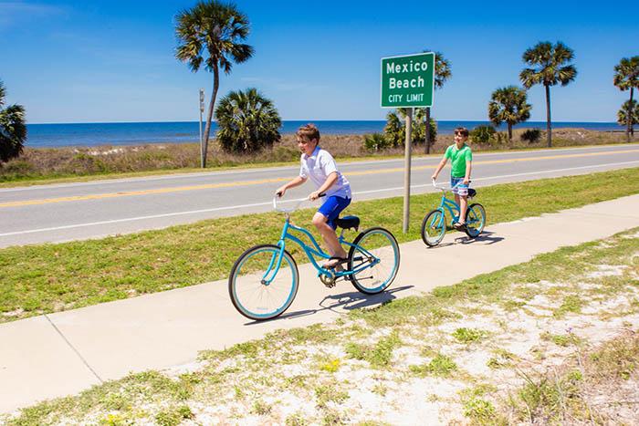 two boys enjoying a bike ride in Mexico Beach Florida