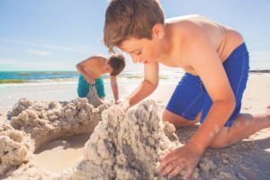 boys playing in the sand at Mexico Beach Florida; Mexico Beach Sandcastles